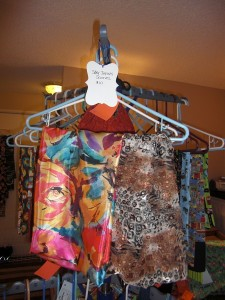 display from trunk show of variety of patterns of infinity scarves