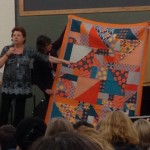 Sam Hunter explaining her quilt